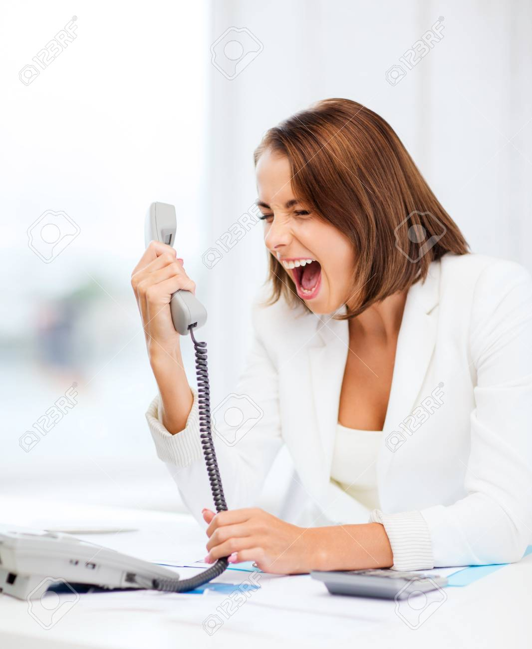 business concept - woman shouting into phone in office Stock Photo - 21681046