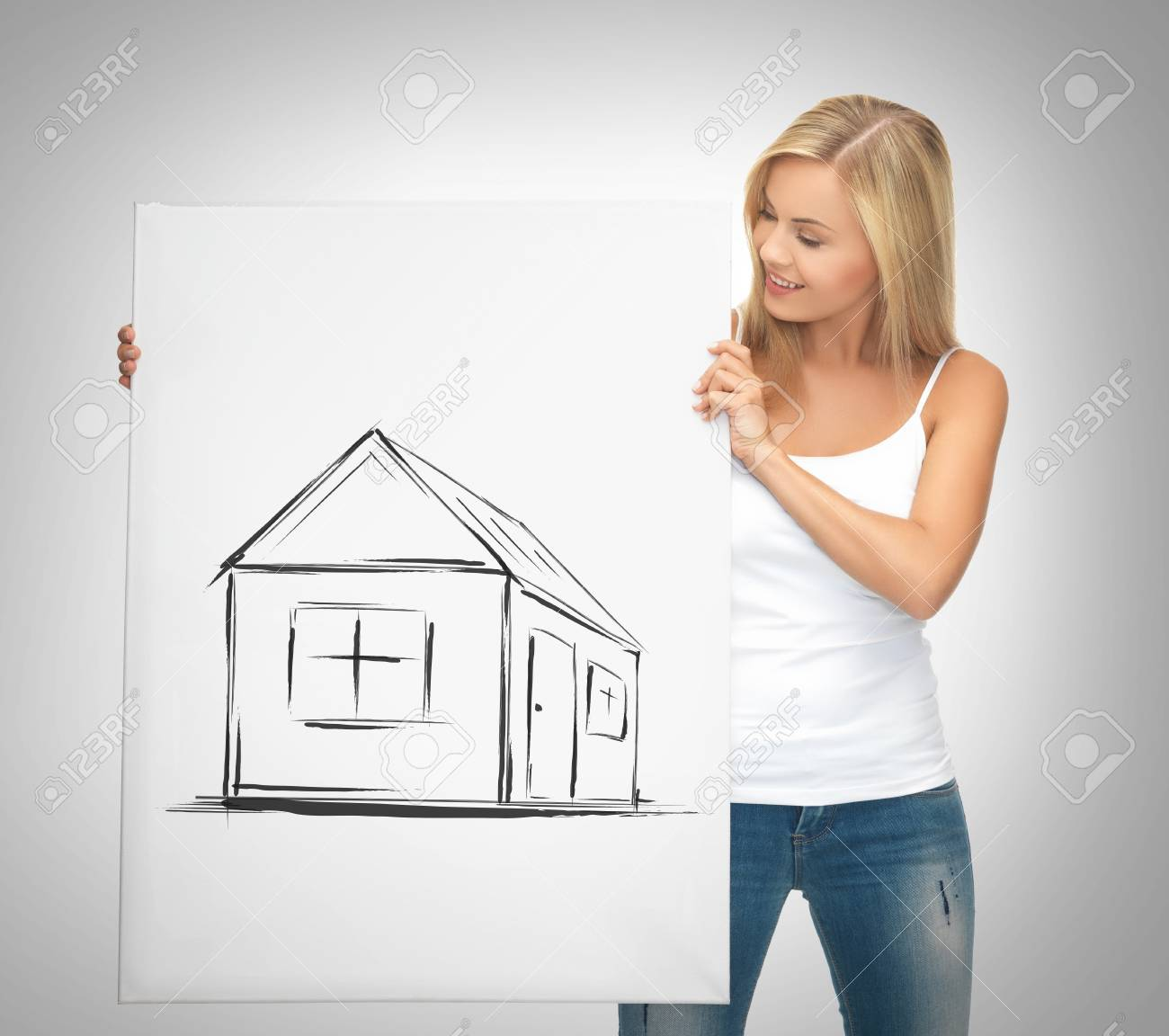 real estate, property, business and accomodation concept - woman holding picture with house Stock Photo - 21945606