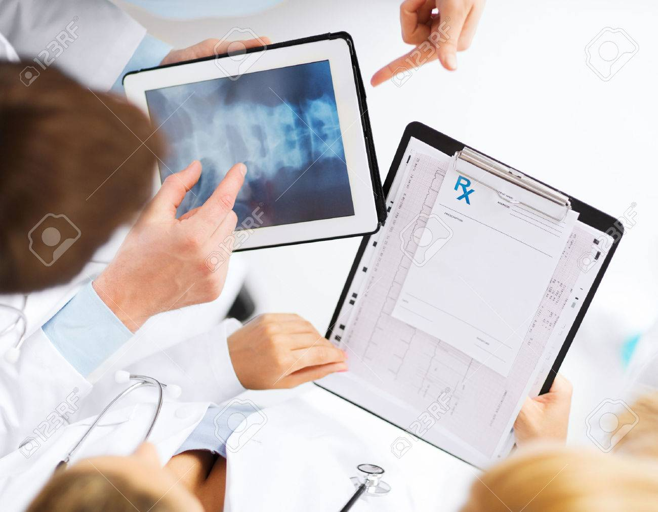 healthcare, hospital and medical concept - group of doctors looking at x-ray on tablet pc Stock Photo - 22185290