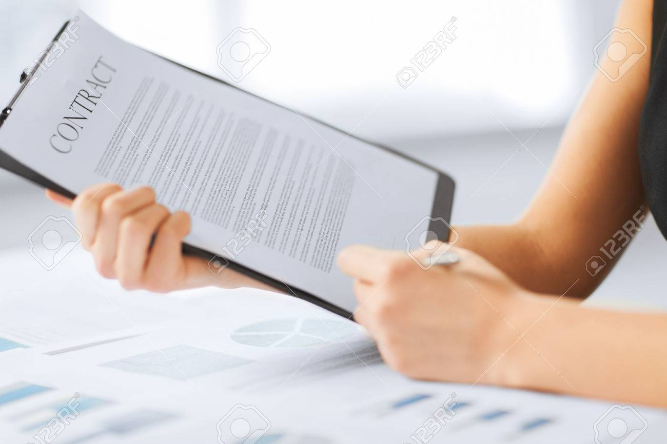 business, office, law and legal concept - picture of woman hand signing contract paper - 22185486