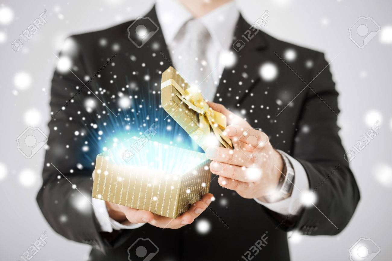 love, romance, holiday, celebration concept - man opening gift box Stock Photo - 22641628