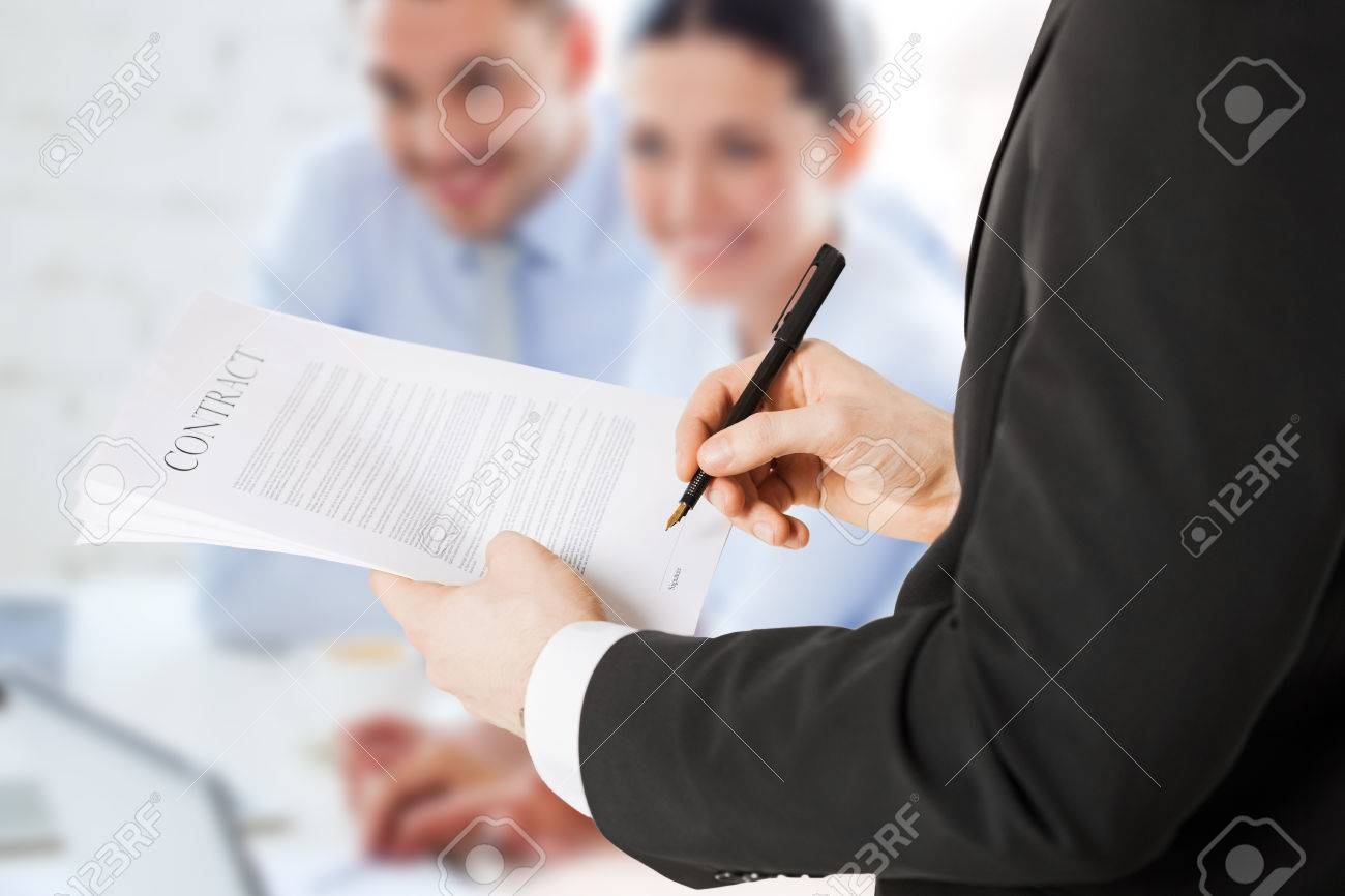 office, buisness, legal, teamwork concept - man signing contract Stock Photo - 22803482