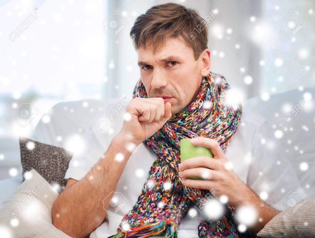 healthcare and medicine concept - ill man with flu at home Stock Photo - 23671463