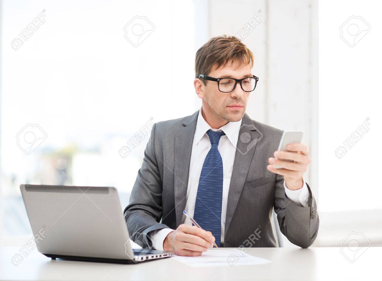 stock photo technology business and office concept handsome businessman working with laptop computer and smartphone business computer