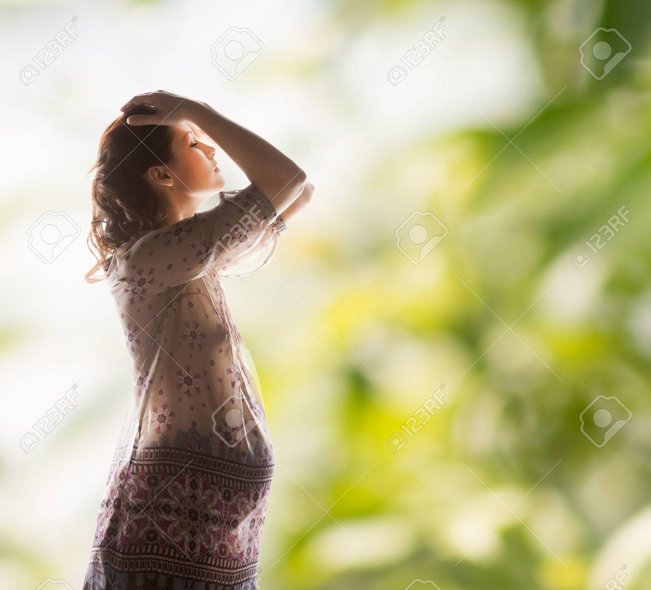 family, motherhood and pregnancy concept - silhouette backlight picture of pregnant beautiful woman Stock Photo - 24221462