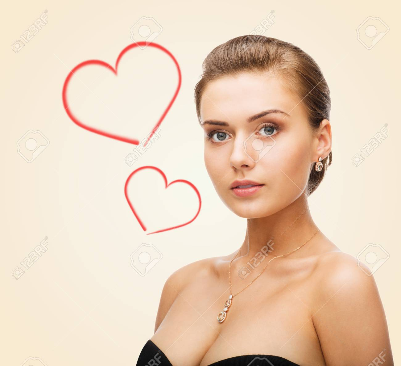 beauty, love and jewelry concept - charming woman wearing shiny diamond earrings Stock Photo - 24371229