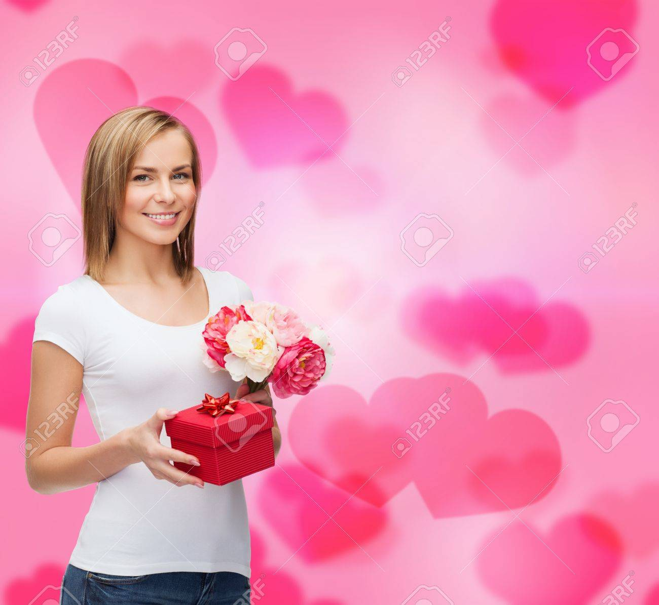 holidays, love and flowers concept - young woman with bouquet of flowers and red gift box Stock Photo - 25509126
