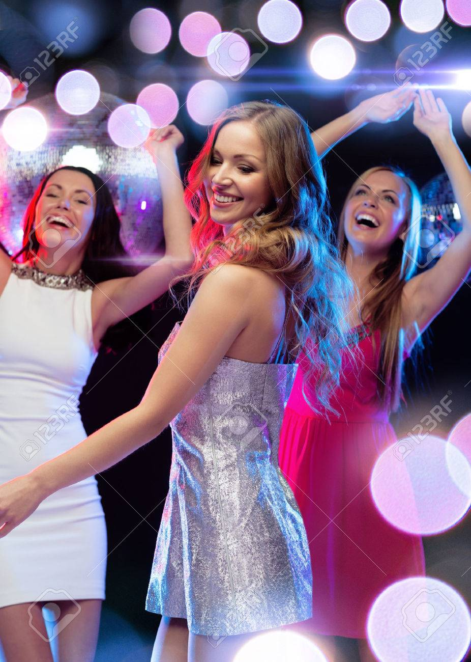 new year, celebration, friends, bachelorette party, birthday concept - three beautiful woman in evening dresses dancing in the club - 28653444