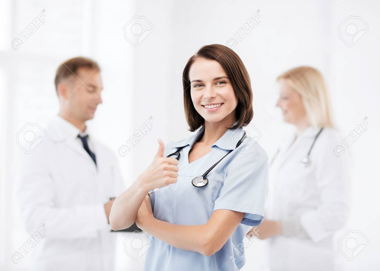 healthcare and medical concept - team of doctors showing thumbs up Stock Photo - 28897984