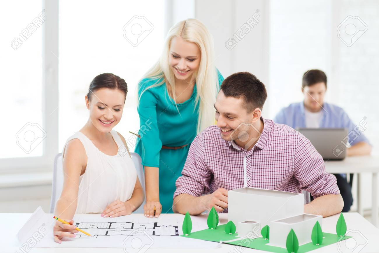 Startup education architecture and office concept smiling startup education architecture and office concept smiling architects with house model and blueprint malvernweather Images