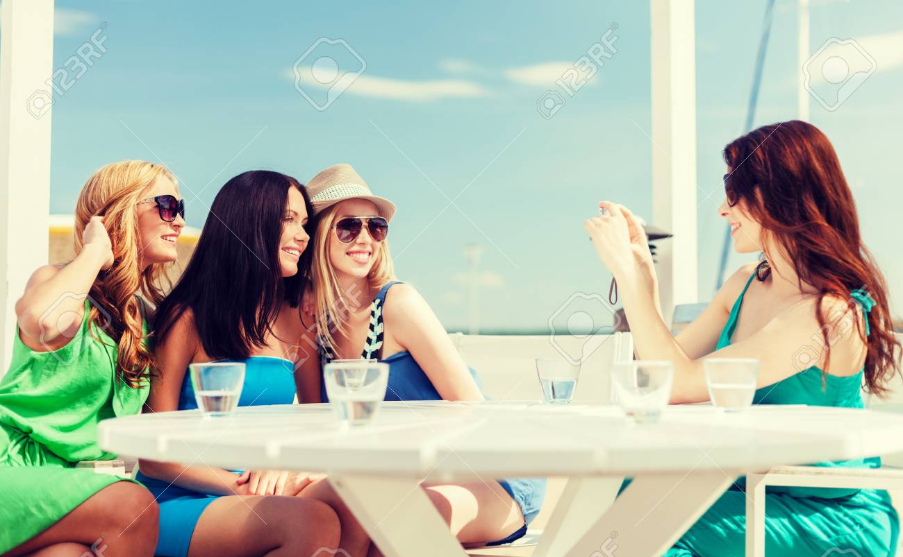 Summer Holidays And Vacation Girls Taking Photo With Digital