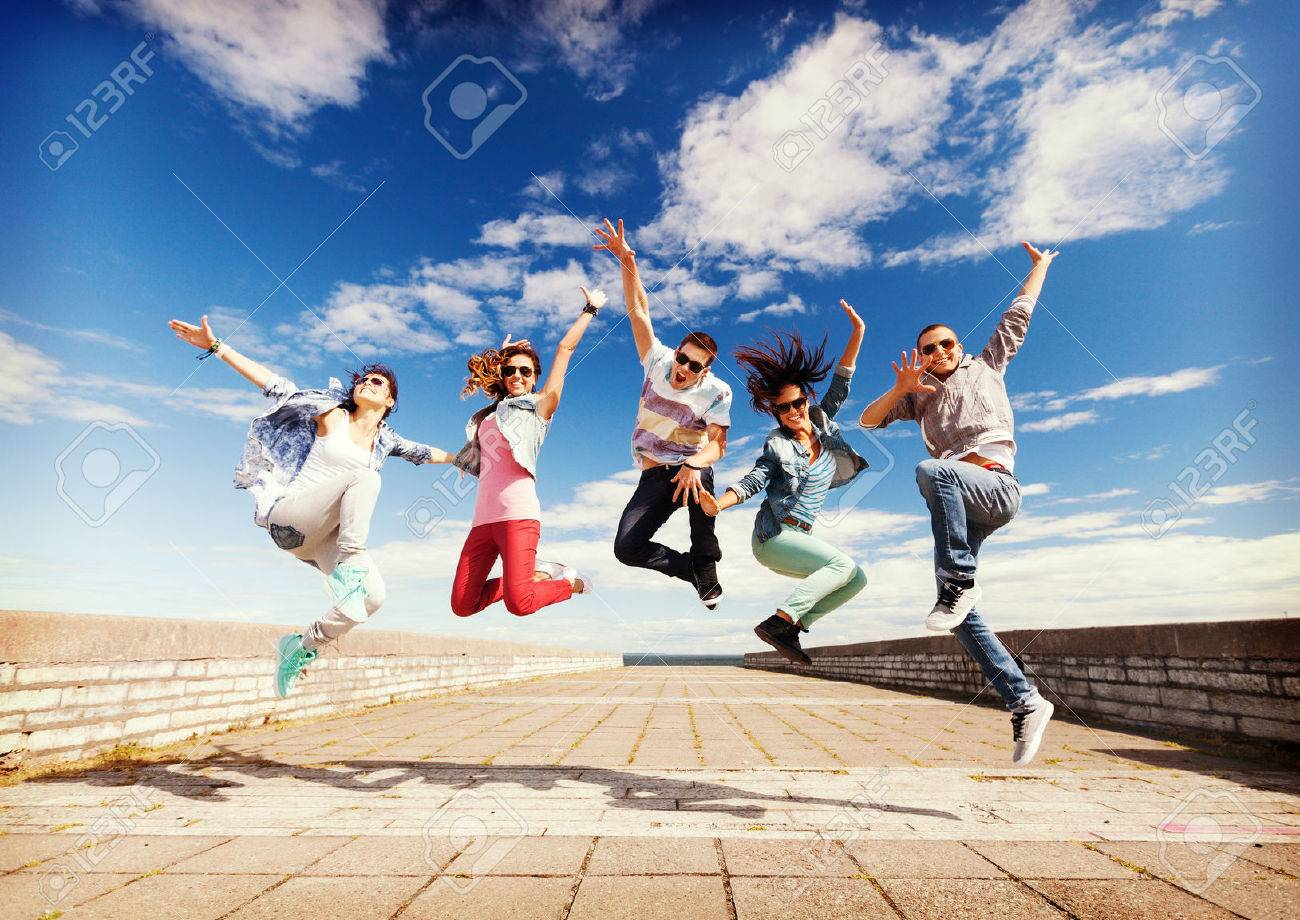 summer, sport, dancing and teenage lifestyle concept - group of teenagers jumping - 31158155