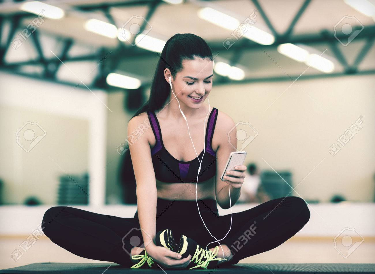 fitness, sport, training, gym, technology and lifestyle concept - smiling woman with smartphone - 32337263
