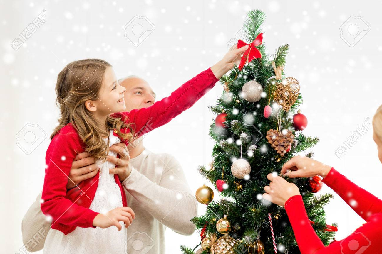 family holidays generation and people concept smiling family decorating christmas tree at home - People Decorating A Christmas Tree