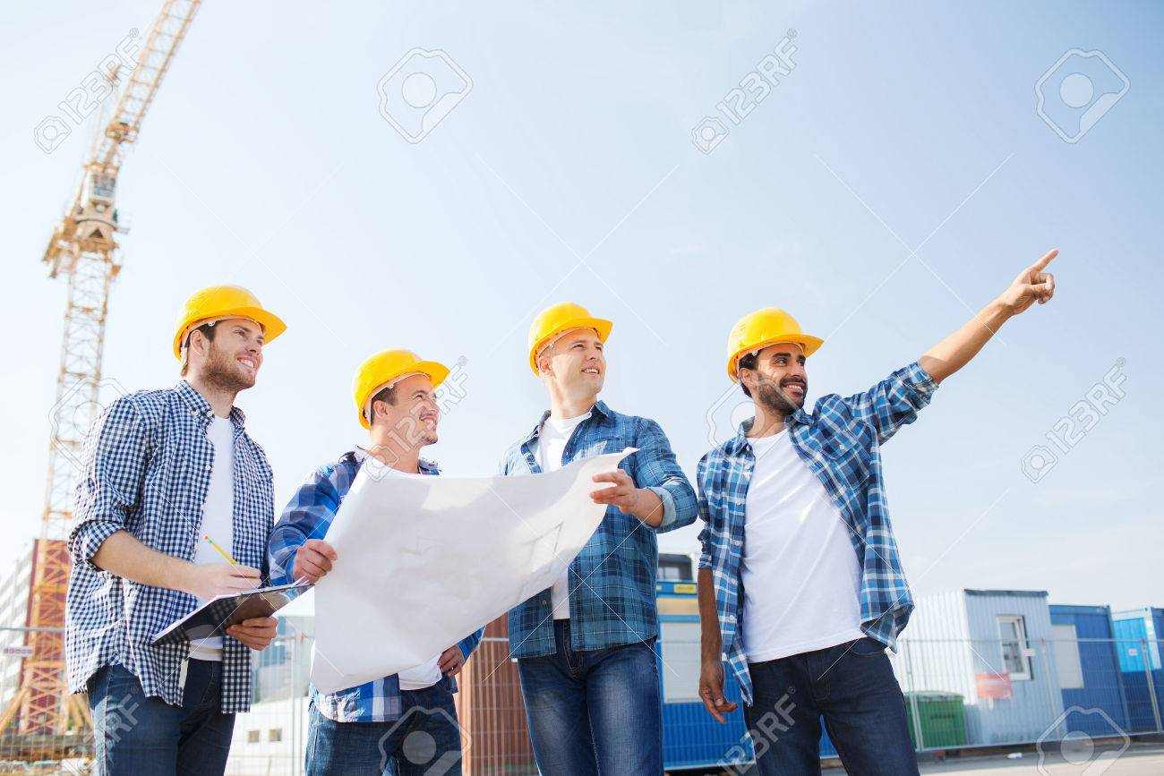 Business building teamwork and people concept group of smiling business building teamwork and people concept group of smiling builders in hardhats with malvernweather Image collections