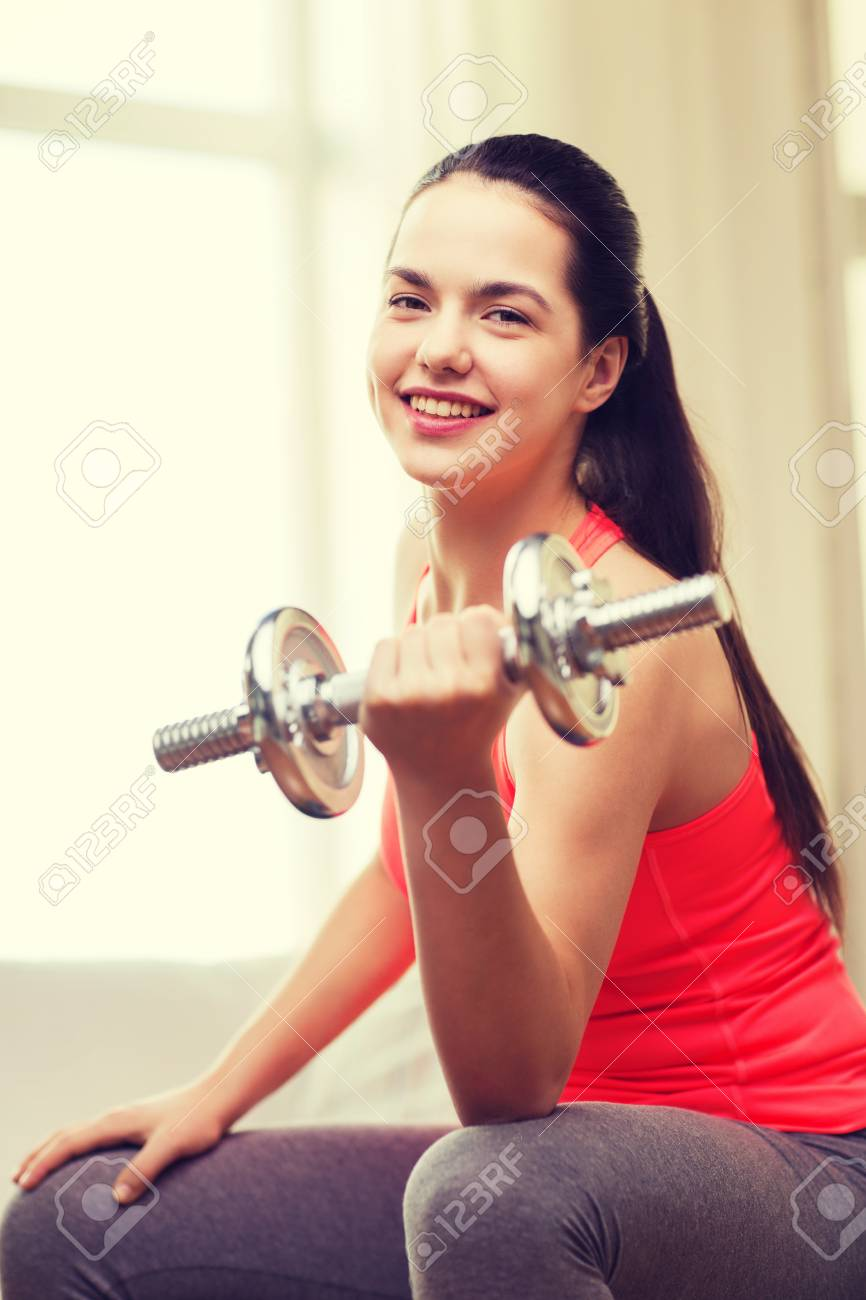 Fitness, Home And Diet Concept - Smiling Girl Exercising