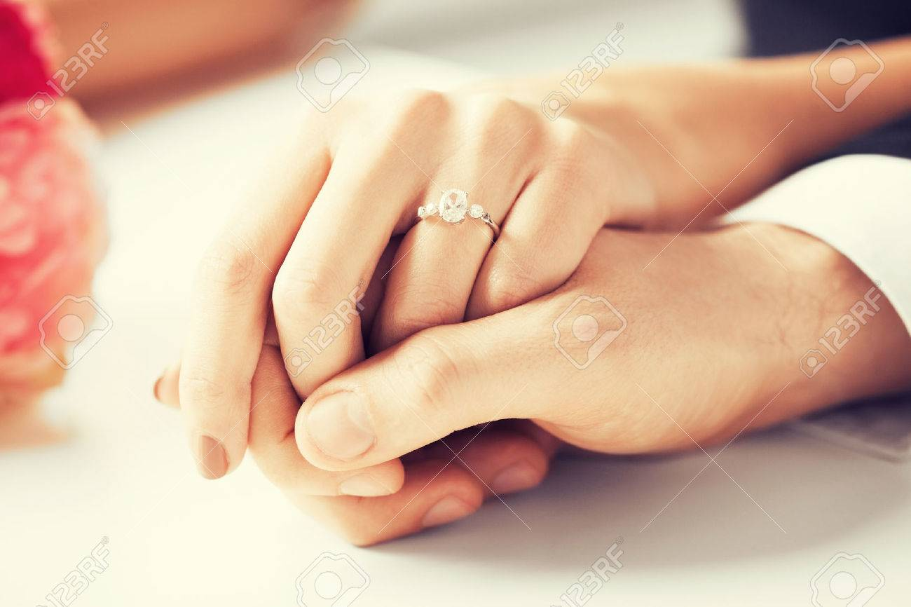 Engagement Ring: Picture Of Man And Woman With Wedding Ring