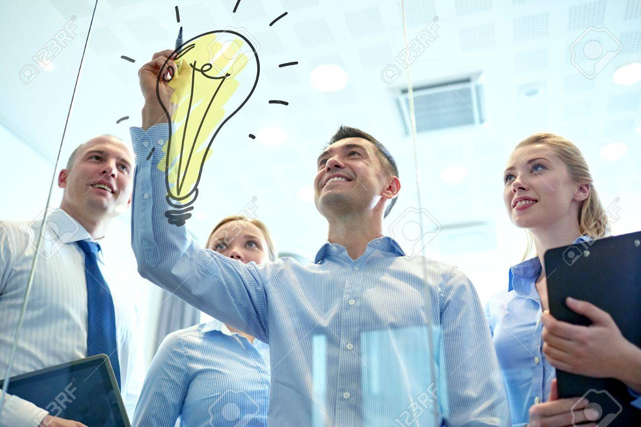business, people, teamwork and planning concept - smiling business team with marker and light bulb doodle working in office - 36049307