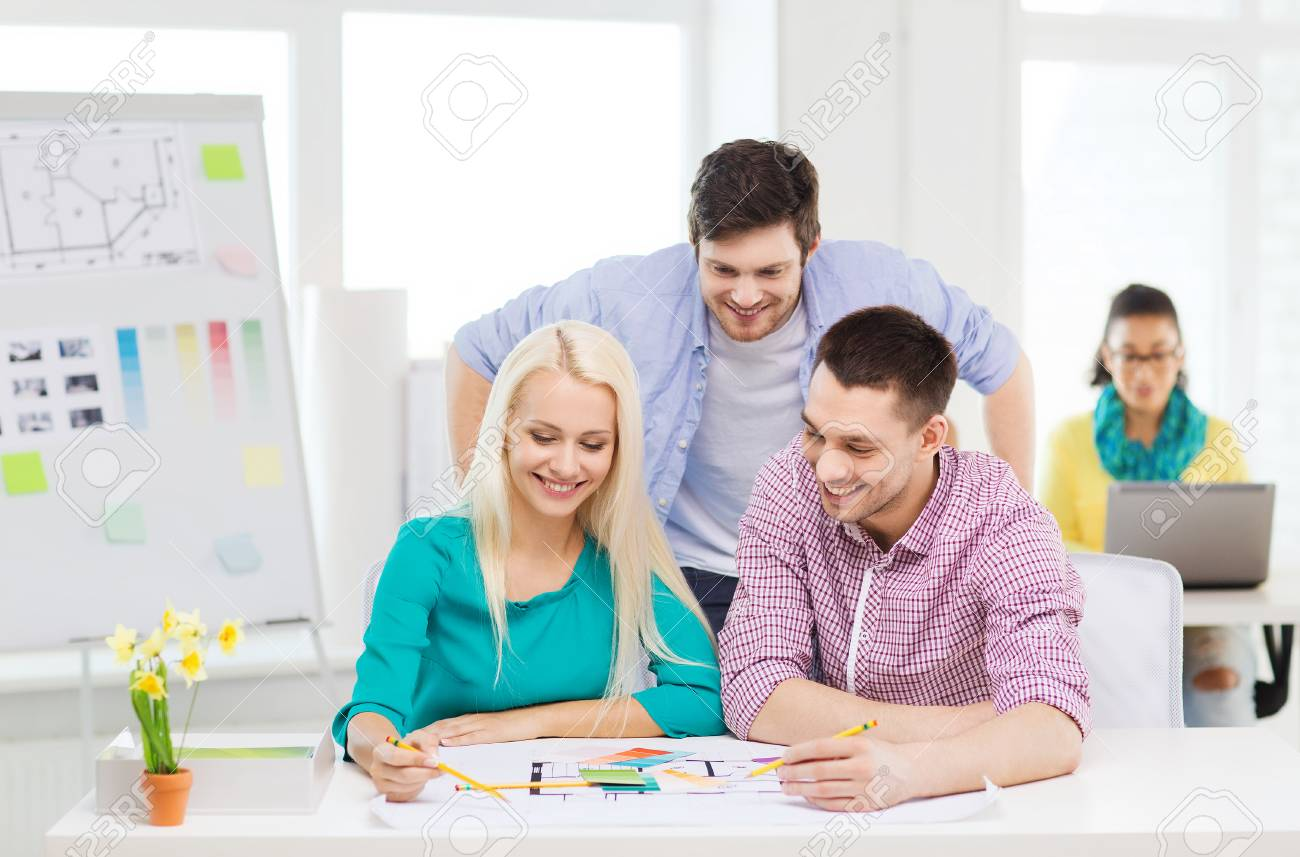 Education interior design and office concept smiling interior education interior design and office concept smiling interior designers with color samples and blueprint malvernweather Gallery