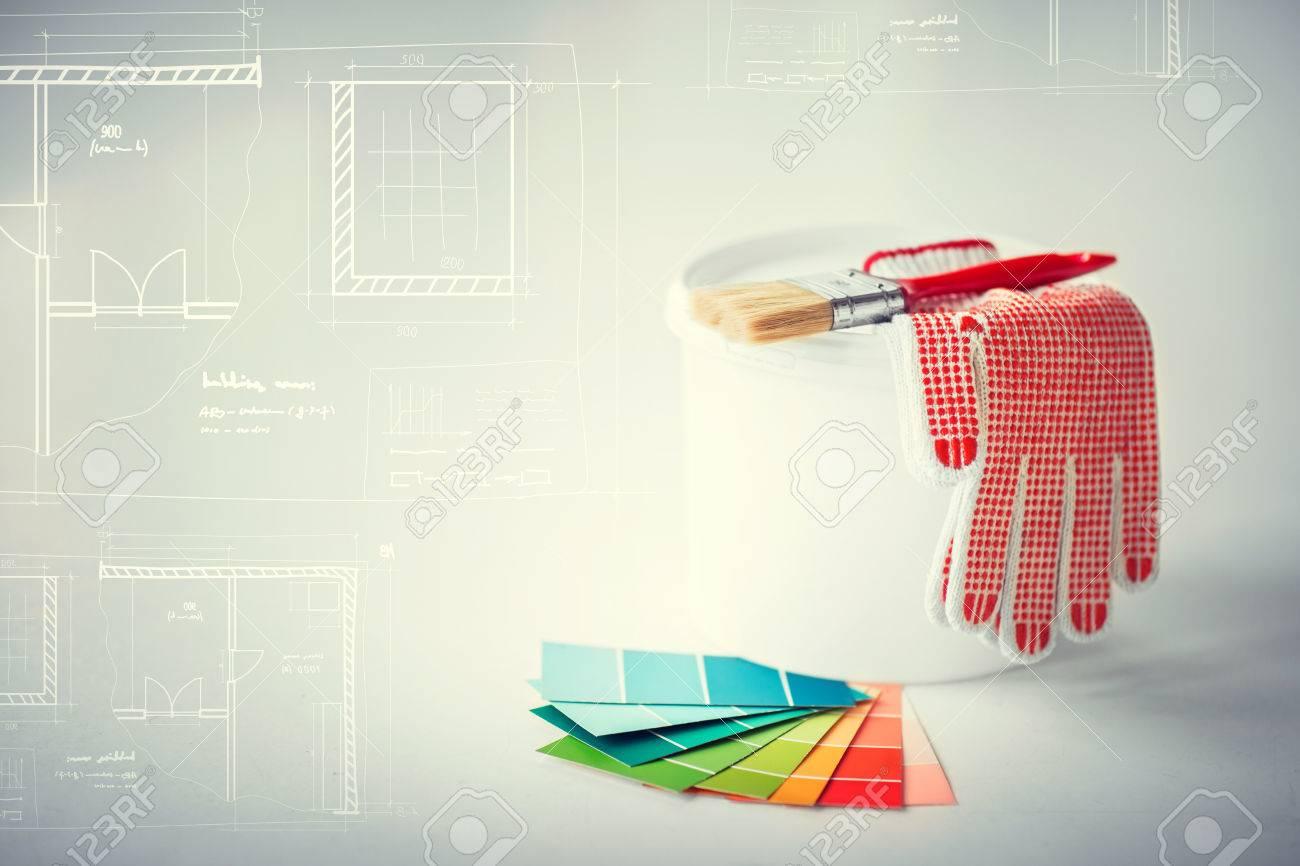 Interior design and home renovation concept paintbrush paint interior design and home renovation concept paintbrush paint pot gloves pantone samplers malvernweather Choice Image