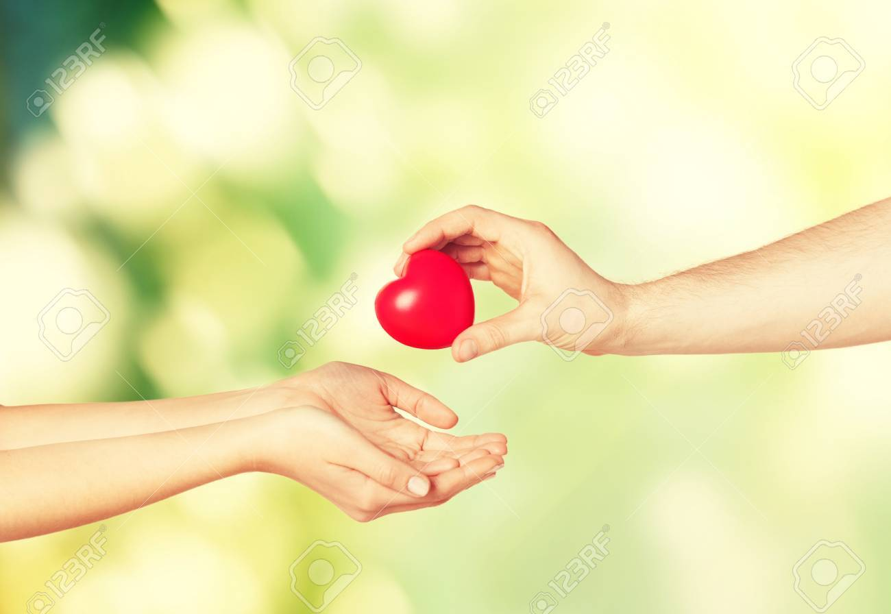 Close Up Of Man Hand Giving Heart To Woman Stock Photo, Picture ...