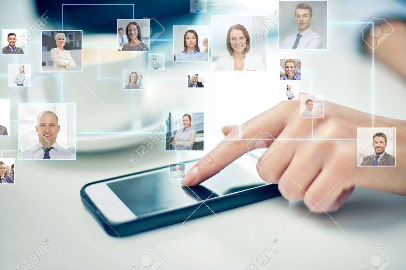 business, technology, global communication and people concept - close up of woman hand with smartphone and contact icons projection Stock Photo - 39649538