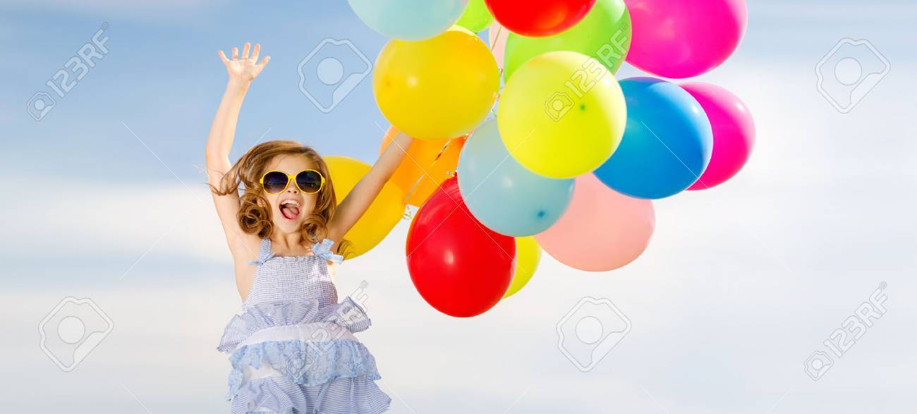 summer holidays, celebration, children and people concept - happy jumping girl with colorful balloons outdoors Stock Photo - 40263585