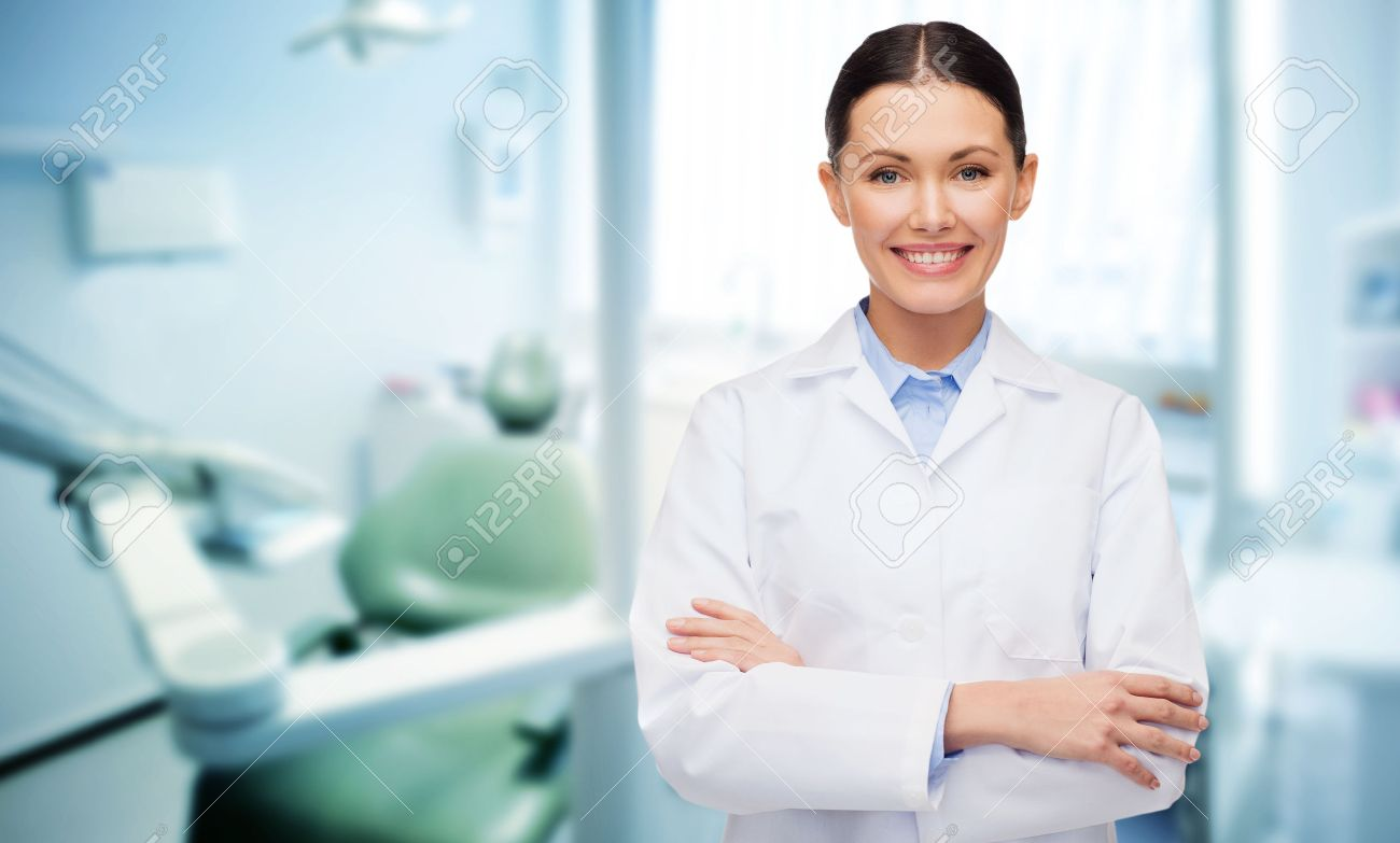 people, medicine, stomatology and healthcare concept - happy young female dentist with tools over medical office background Stock Photo - 45904877