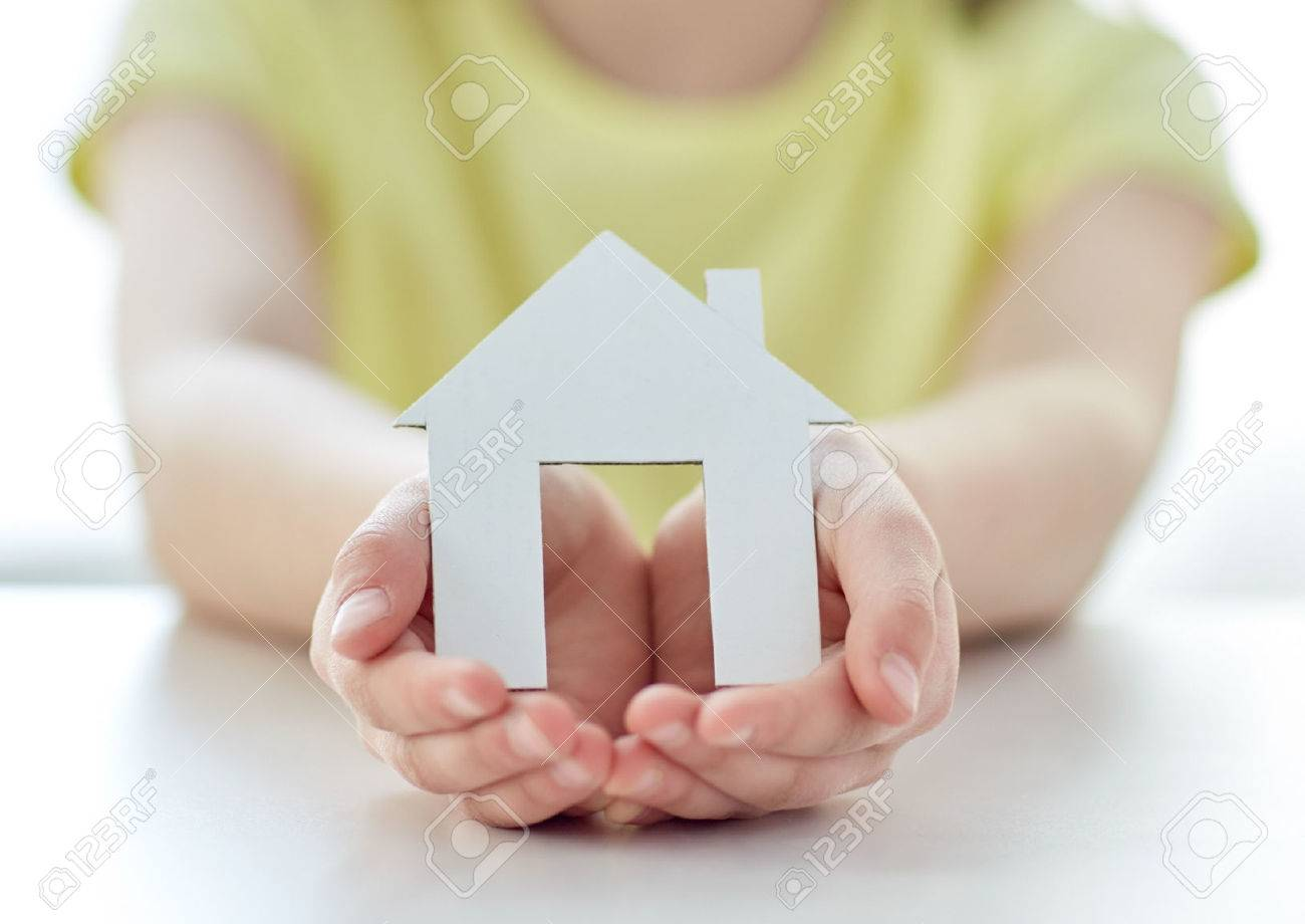 people, charity, family and home concept - close up of happy girl holding paper house cutout in cupped hands Stock Photo - 46140251