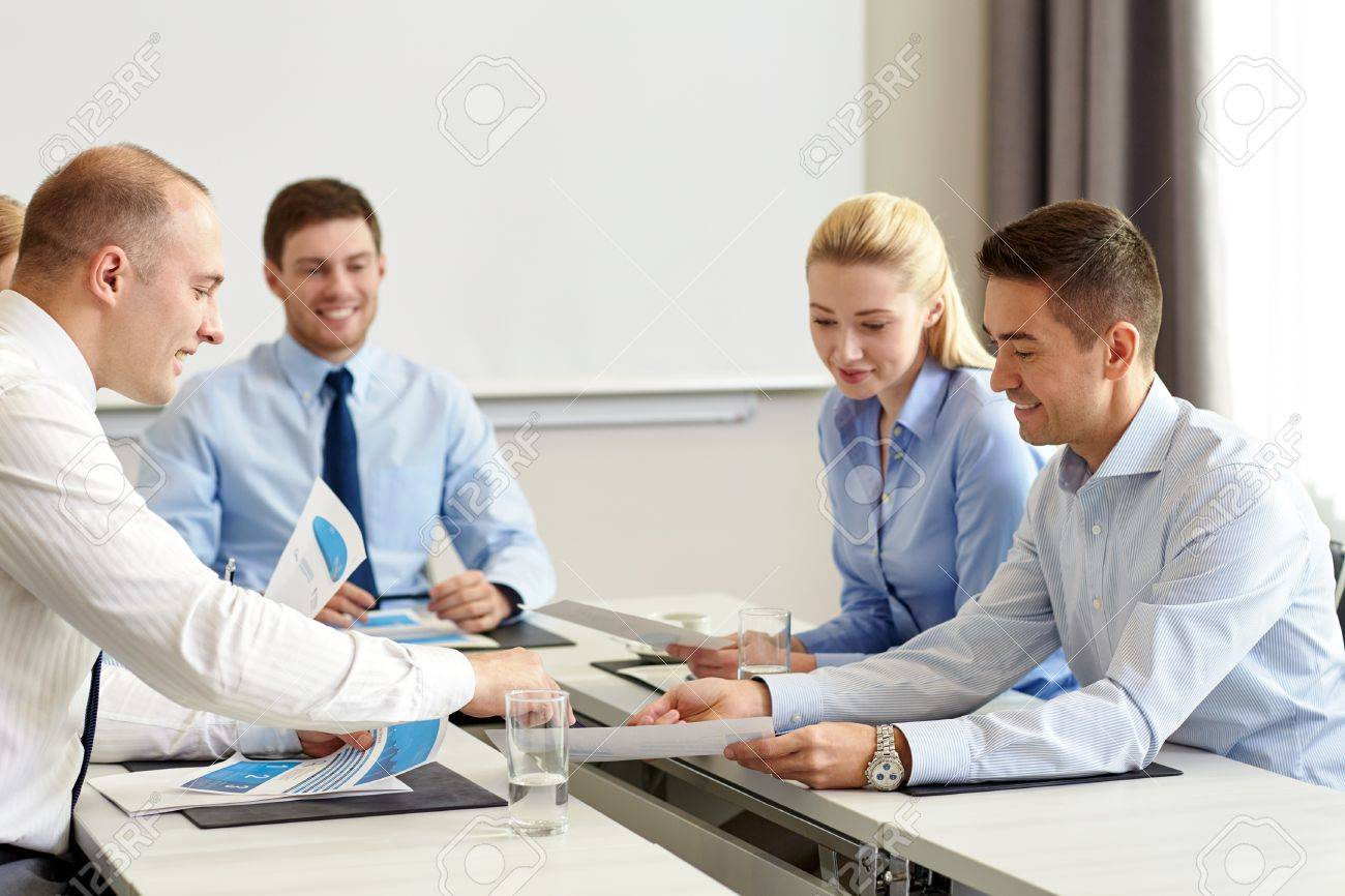 business, people and teamwork concept - smiling business team with papers meeting in office - 46140268
