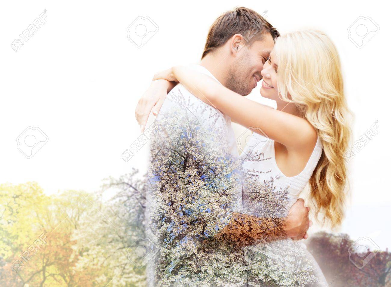 spring, love, romance, double exposure and dating concept - happy couple hugging over cherry blossom background Stock Photo - 47366759