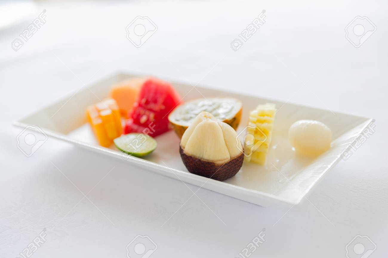 Cooking, Kitchen And Food Concept - Plate Of Fresh Juicy Fruit ...