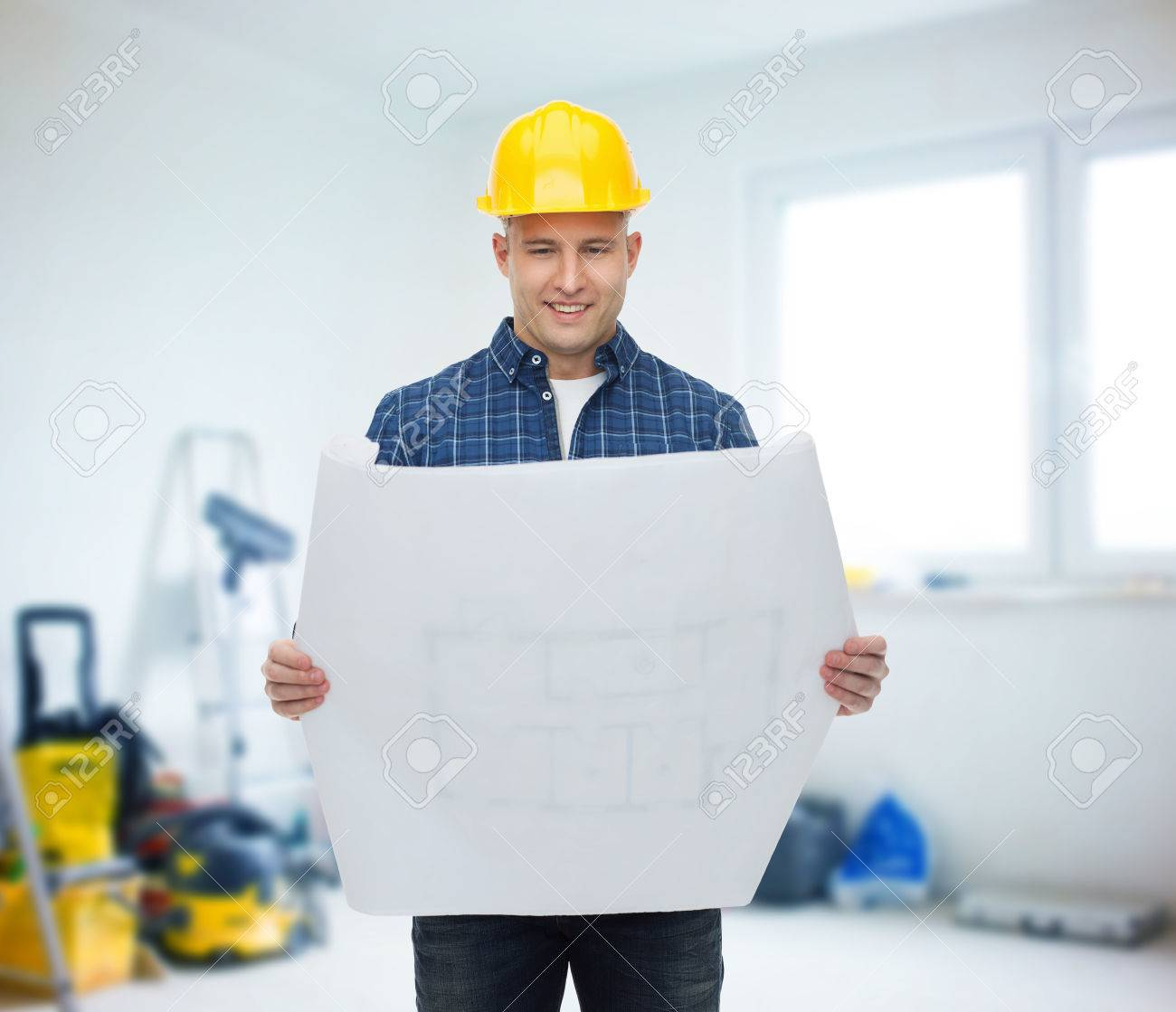 Repair construction building people and maintenance concept repair construction building people and maintenance concept smiling male builder or manual malvernweather Images