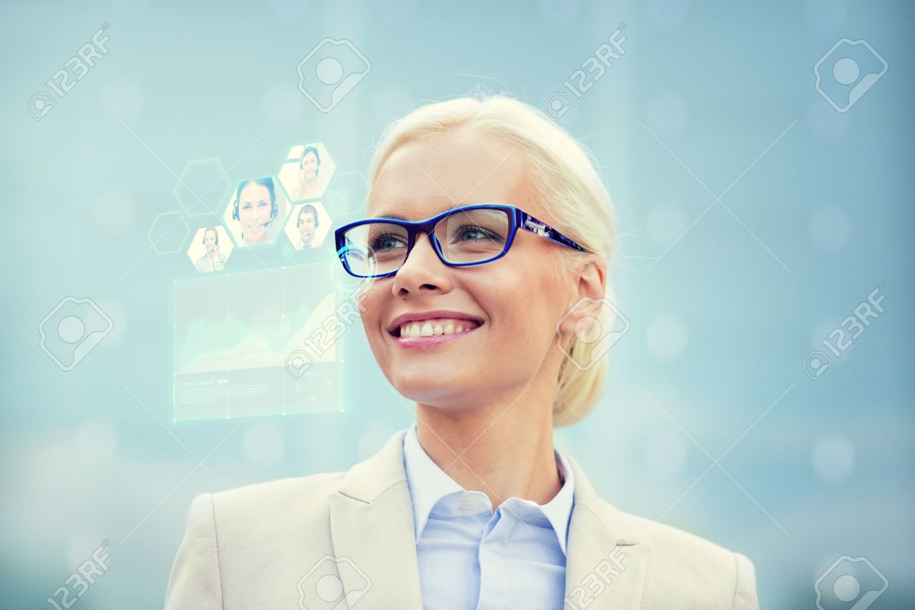 business, people, future technology and communication concept - young smiling businesswoman in eyeglasses with virtual screen, video chat and charts projection outdoors Stock Photo - 47871983