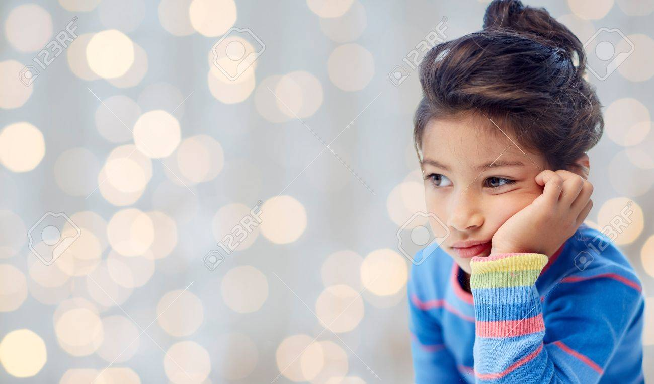 people, childhood and emotions concept - sad and disappointed or bored little girl over holidays lights background - 48379923