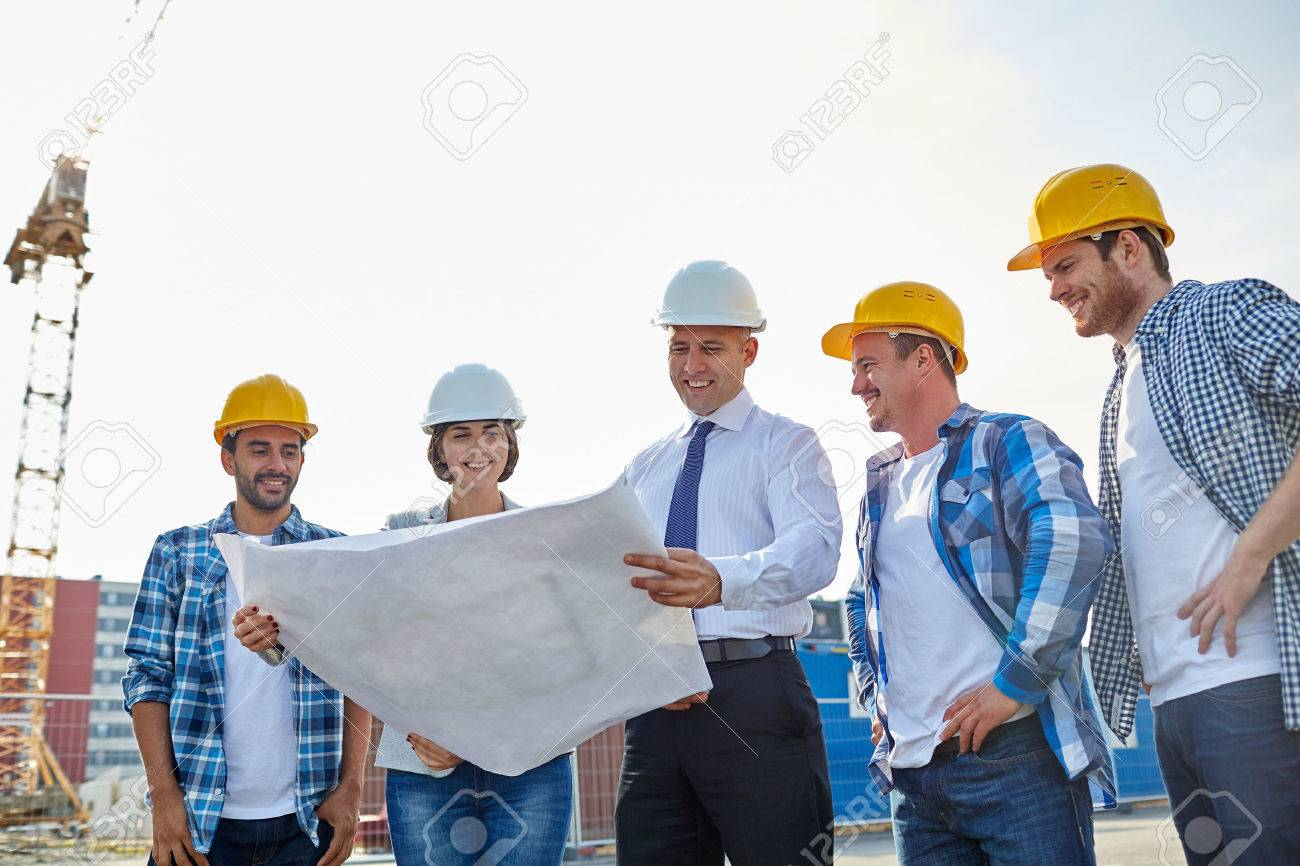 Business building teamwork and people concept group of builders business building teamwork and people concept group of builders and architects in hardhats malvernweather Images