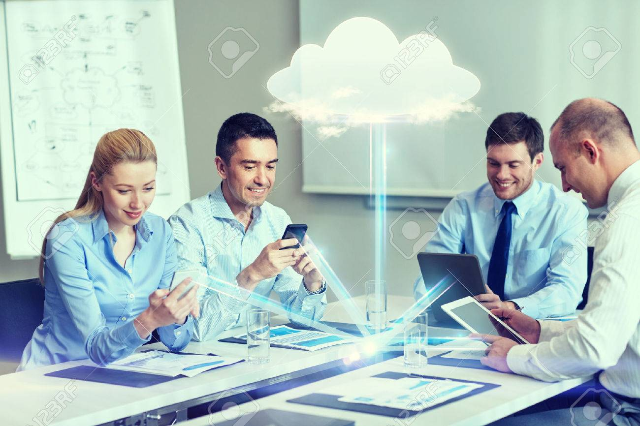 business, people, cloud computing and technology concept - smiling business team with smartphones, tablet pc computers working in office - 48791348