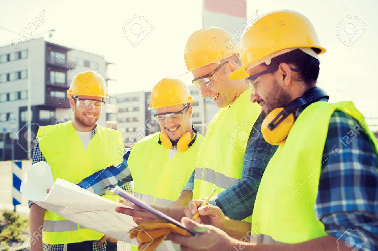 Business building teamwork and people concept group of smiling business building teamwork and people concept group of smiling builders in hardhats with malvernweather Images