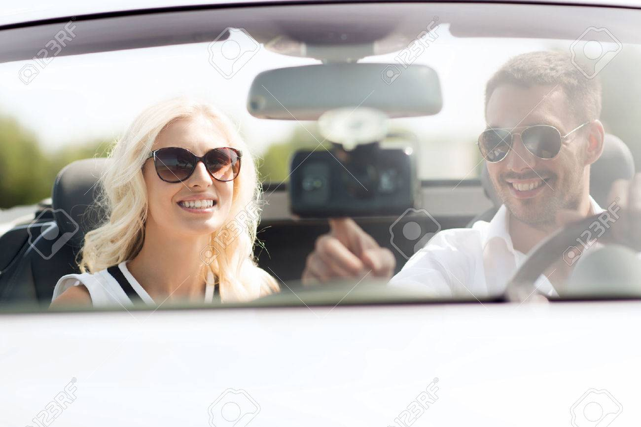 road trip, leisure, travel, technology and people concept - happy man and woman driving car and using gps navigation system - 50278148