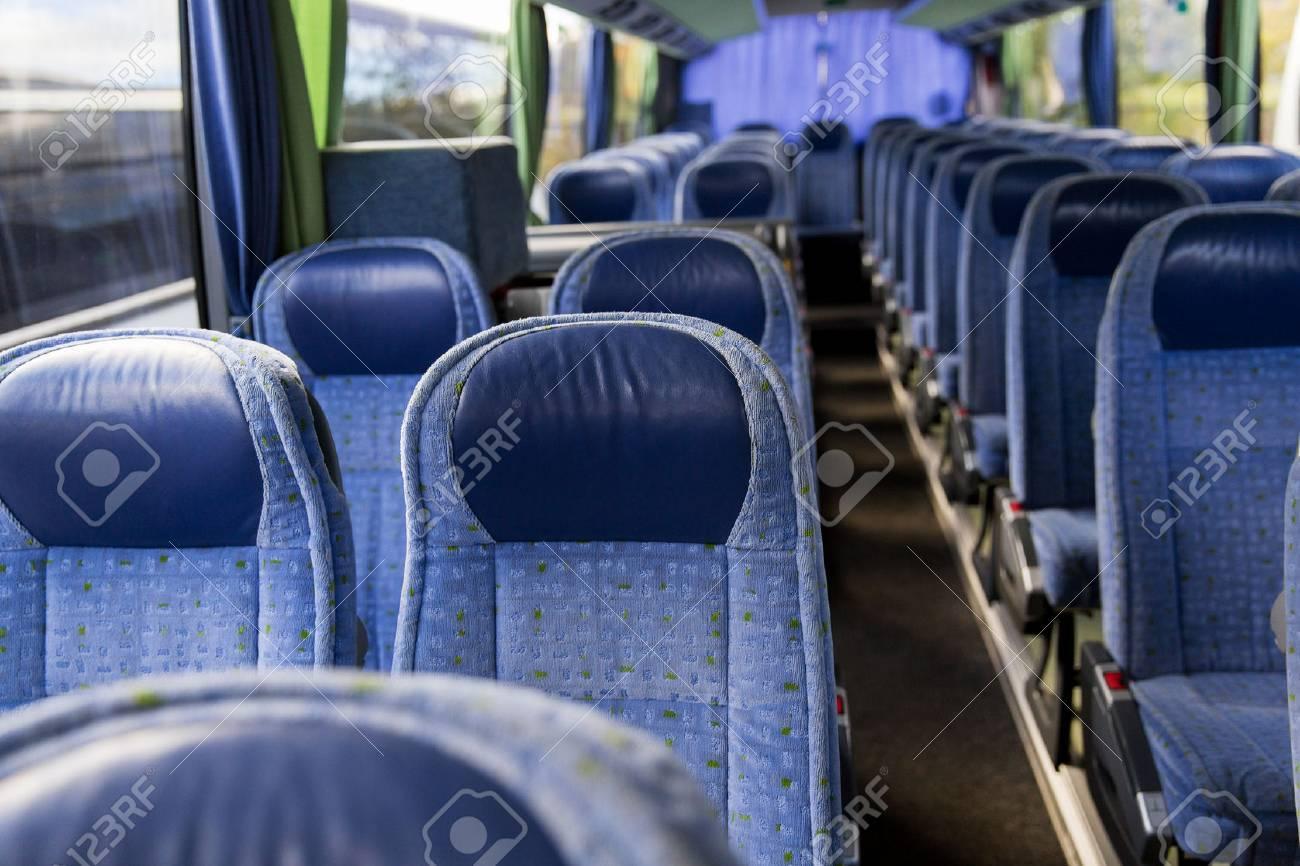transport, tourism, road trip and equipment concept - travel bus interior - 50944429