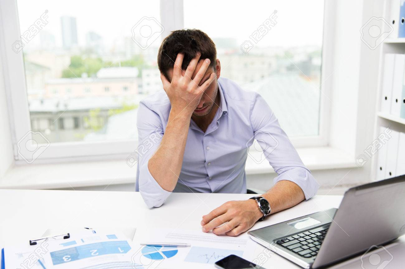 business, people, fail, paperwork and technology concept - businessman with laptop computer and papers working in office - 51023559