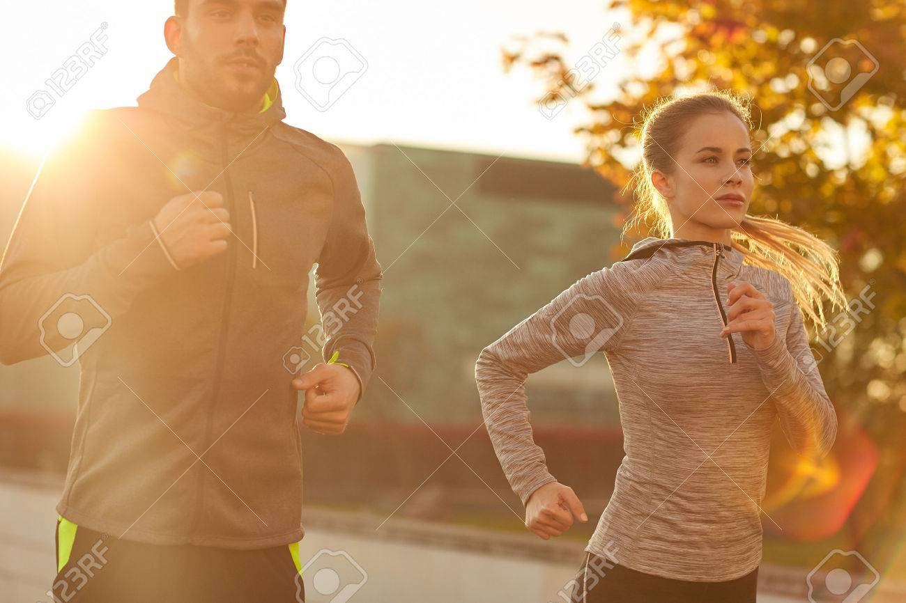 fitness, sport, people and lifestyle concept - couple running outdoors Stock Photo - 51225209