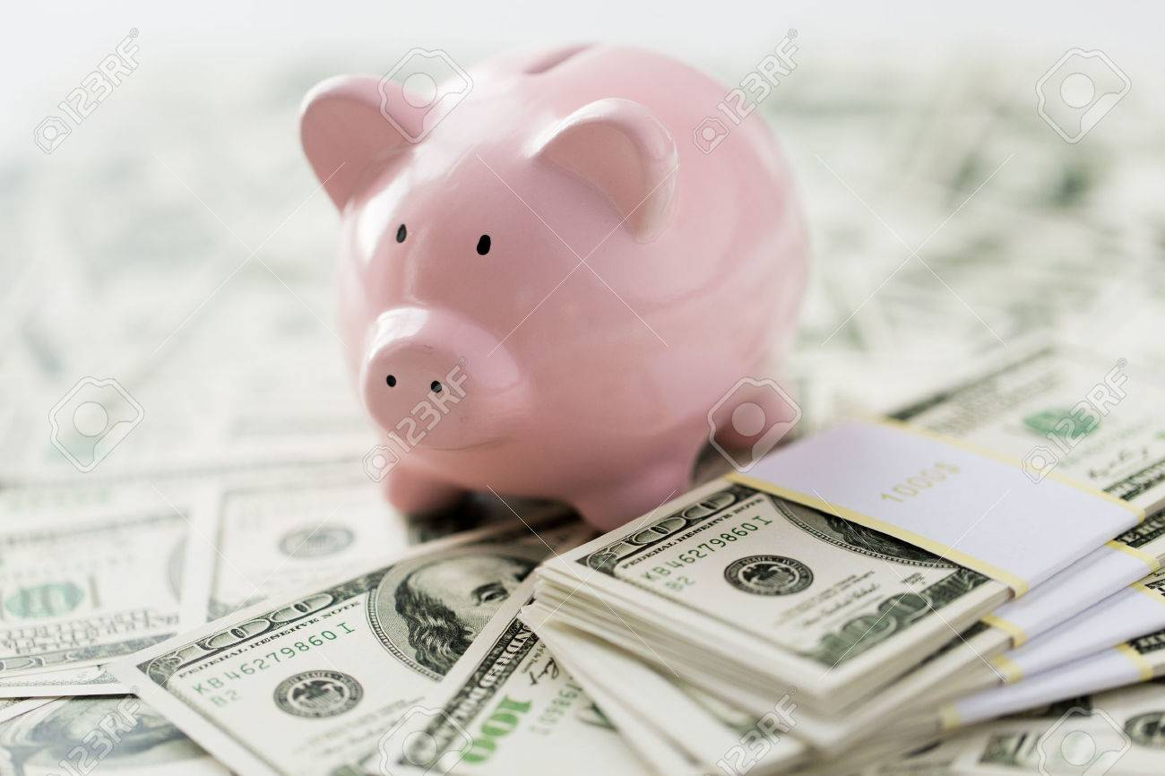 business, finance, investment, saving and corruption concept - close up of dollar cash money and piggy bank on table - 51238220