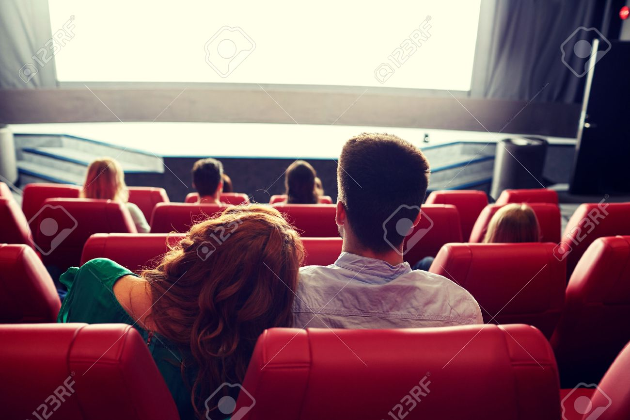 cinema, entertainment, leisure and people concept - happy, couple watching movie in theater from back - 51333513