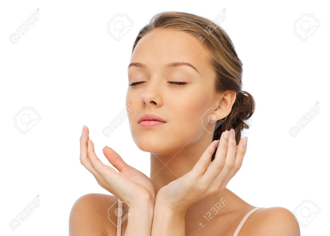 beauty, people, skincare and health concept - young woman face and hands - 51334613