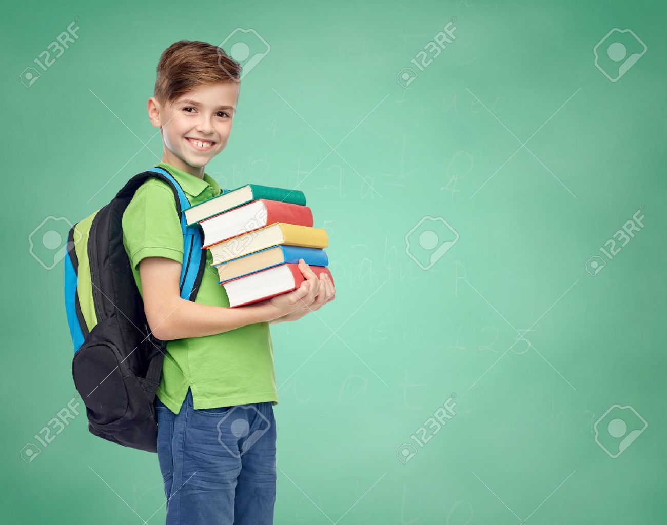 happy smiling student boy with school bag and books over green school chalk board background - 51808954