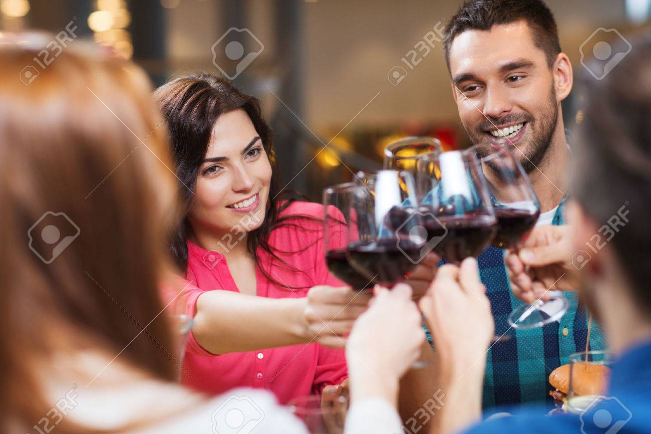 happy couple and friends clinking glasses of wine at restaurant - 51808256