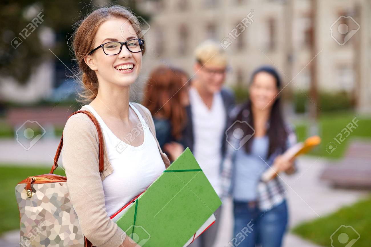 education, campus, friendship and people concept - group of happy teenage students with school folders - 51847123