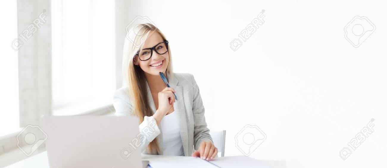 business and education concept - indoor picture of smiling woman with documents and pen - 52256707