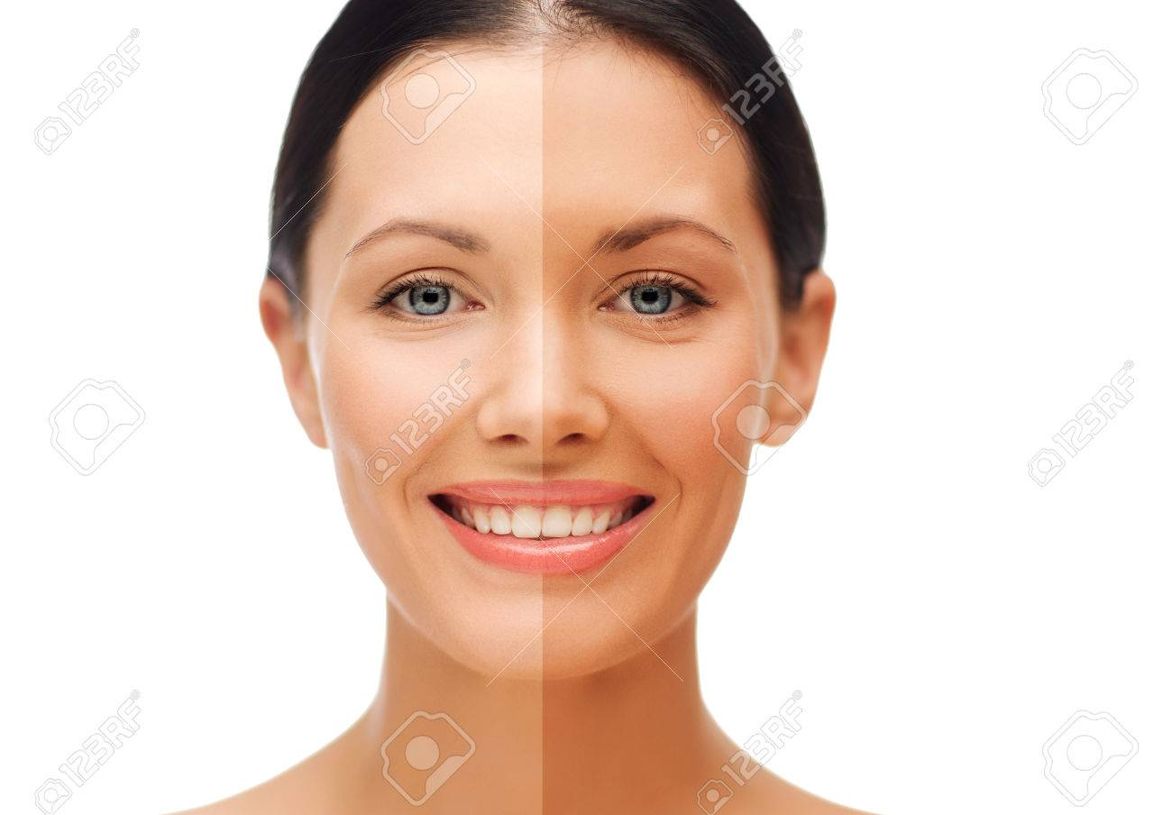 beauty and health concept - beautiful woman with half face tanned - 53495640